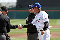 Buffalo Bisons manager Tim Teufel #11 greets the umpires before a game against the Syracuse Chiefs at Dunn Tire Park on April 7, 2011 in Buffalo, New York.  Syracuse defeated Buffalo 8-5.  Photo By Mike Janes/Four Seam Images