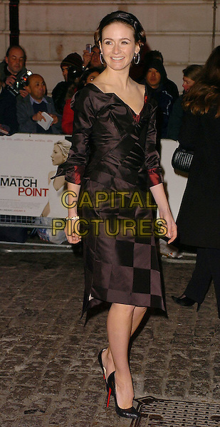 EMILY MORTIMER .Match Point UK Premiere Arrivals held at Curzon Mayfair Cinema, London..UK, United Kingdom..18th December 2005.Ref: CAN.full length black silk satin corset style top matching skirt alice hair band hoop earrings high heeled stilettoes.www.capitalpictures.com.sales@capitalpictures.com.©Capital Pictures