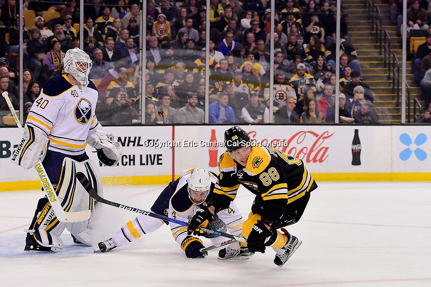 Monday, November 7, 2016: Boston Bruins right wing David Pastrnak (88) battles Buffalo Sabres defenseman Josh Gorges (4) as Buffalo Sabres goalie Robin Lehner (40) tends the net during the National Hockey League game between the Buffalo Sabres and the Boston Bruins held at TD Garden, in Boston, Mass. Eric Canha/CSM