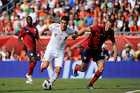 David Villa (7) of Spain is marked by Jonathan Spector (2) of the United States. The men's national team of Spain (ESP) defeated the United States (USA) 4-0 during a International friendly at Gillette Stadium in Foxborough, MA, on June 04, 2011.