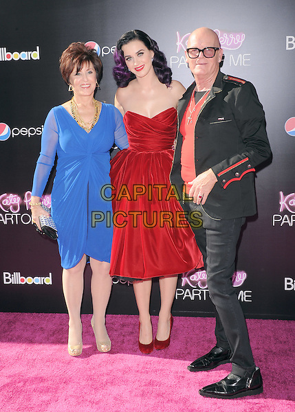 "Mary Perry, Katy Perry, Keith Hudson.""Katy Perry: Part Of Me"" Los Angeles Premiere held at Grauman's Chinese Theatre, Hollywood, California, USA..June 26th, 2012.full length red strapless velvet dress  dyed purple hair blue black jacket jeans denim glasses father dad daughter mother mom mum parents .CAP/RKE/DVS.©DVS/RockinExposures/Capital Pictures."