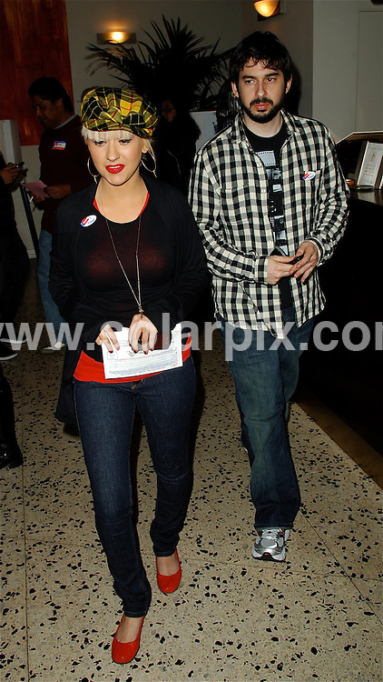 **ALL ROUND PICTURES FROM SOLARPIX.COM**.**WORLDWIDE SYNDICATION RIGHTS EXCEPT FOR USA, AUSTRALIA & GERMANY**.Christina Aguilera, with her husband Jordan Bratman, turning out to vote in the US election in West Hollywood, California, USA. 4th November 2008...JOB REF: 7794 LAS       DATE: 04_11_2008.**MUST CREDIT SOLARPIX.COM OR DOUBLE FEE WILL BE CHARGED* *UNDER NO CIRCUMSTANCES IS THIS IMAGE TO BE REPRODUCED FOR ANY ONLINE EDITION WITHOUT PRIOR PERMISSION*