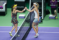 Agnieszka Radwanska of Poland shakes hands with Maria Sharapova of Russia in the BNP Paribas WTA Finals
