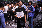 Unemployed China 1990s woman worker advertise her skills at  unofficial local job market with hand written card Yiwu Zhejiang Province 1999