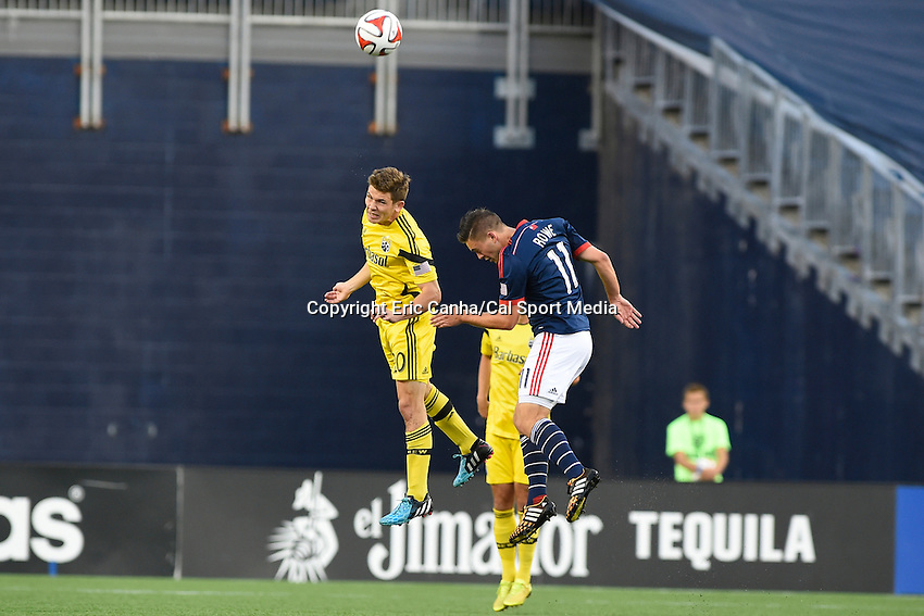 July 26, 2014 - Foxborough, Massachusetts, U.S. - Columbus Crew midfielder Wil Trapp (20) and New England Revolution midfielder Kelyn Rowe (11) play for the ball  during the MLS game between the Columbus Crew and the New England Revolution held at Gillette Stadium in Foxborough Massachusetts.  Eric Canha/CSM