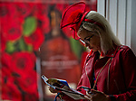 LOUISVILLE, KY - MAY 05: A woman looks at the program on Kentucky Derby Day at Churchill Downs on May 5, 2018 in Louisville, Kentucky. (Photo by Scott Serio/Eclipse Sportswire/Getty Images)
