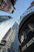 USA, New York City, Manhattan, Time square at crossing Broadway , Ernst & Young EY E&Y,  multinational company provides assurance, financial audit, tax, consulting and advisory services