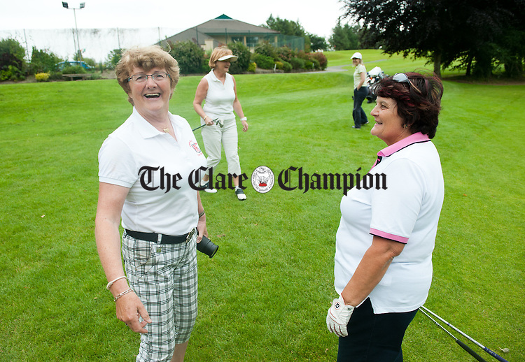 Lady Captain's Mary Mc Mahon chatting with golfer Nuala D'Auria during her prize at Ennis Golf Club. Photograph by John Kelly.