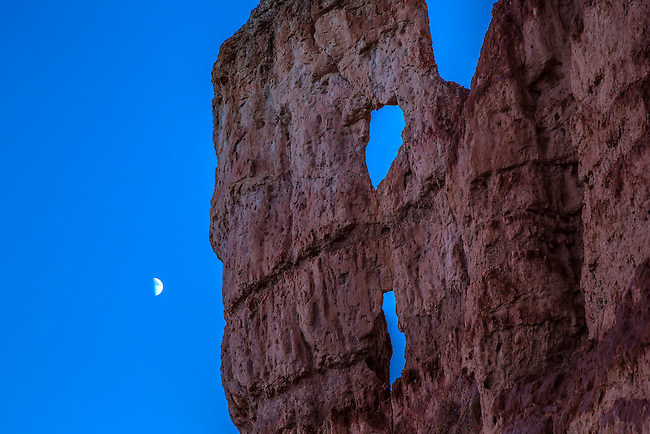 A Half Moon appears next to a Hoodood at Bryce Canyon National Park, Utah