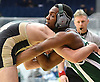 Akhil Champagne of Valley Stream North, right, battles Larry Baker of Wantagh at 195 pounds during the Nassau County Divsision I varsity wrestling quarterfinals at Hofstra University on Saturday, Feb. 11, 2017. Champagne won the match by decision 6-4.