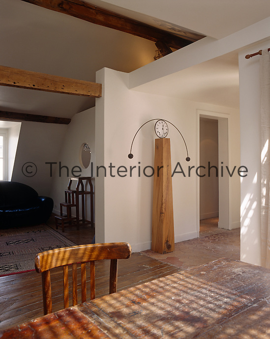 The living and dining areas are situated under the eaves on the attic floor and have been left open plan to make the most of the available space