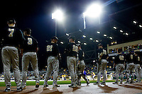 The Wake Forest Demon Deacons wait for their turn to take infield practice prior to playing the LSU Tigers at Alex Box Stadium on February 18, 2011 in Baton Rouge, Louisiana.  The Tigers defeated the Demon Deacons 15-4.  Photo by Brian Westerholt / Four Seam Images