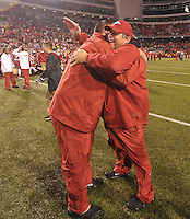 NWA Media/Michael Woods --11/22/2014-- w @NWAMICHAELW...University of Arkansas coach Bret Bielema and offensive coordinator Jim Chaney celebrate on the sidelines after their 30-0 win over Ole Miss during Saturdays game at Razorback Stadium.