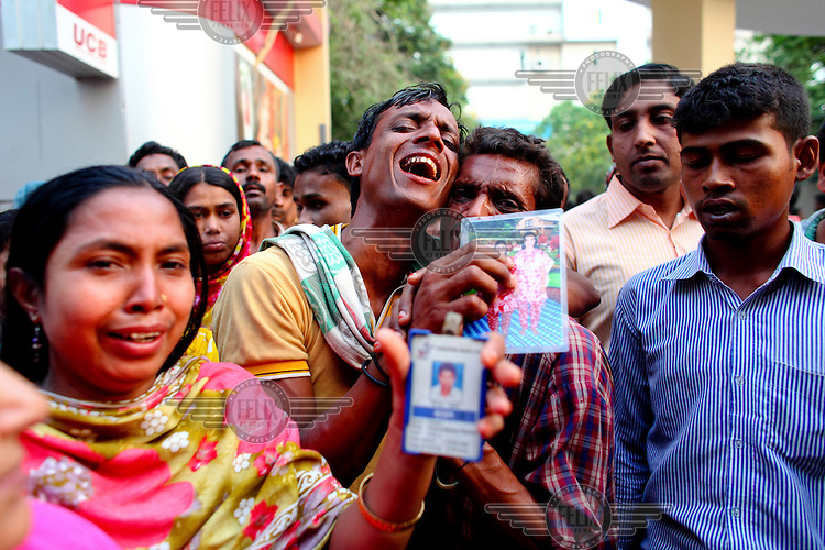Relatives of dead and missing garment workers mourn and wail outside the collapsed Rana Plaza complex in Savar, holding up pictures of their loved ones. ..The 8 storey building, which housed a number of garment factories employing over 3,000 workers, collapsed on 24 April 2013. By 29 April, at least 380 were known to have died while hundreds remained missing. Workers who were worried about going to work in the building when they noticed cracks in the walls were told not to worry by the building's owner, Mohammed Sohel Rana, who is a member of the ruling Awami League's youth front. He fled his home and tried to escape to neighbouring India after the building collapsed but was caught by police and brought back to Dhaka. Some of the factories working in the Rana Plaza building produce cheap clothes for various European retailers including Primark in the UK and Mango, a Spanish label. . /Felix Features