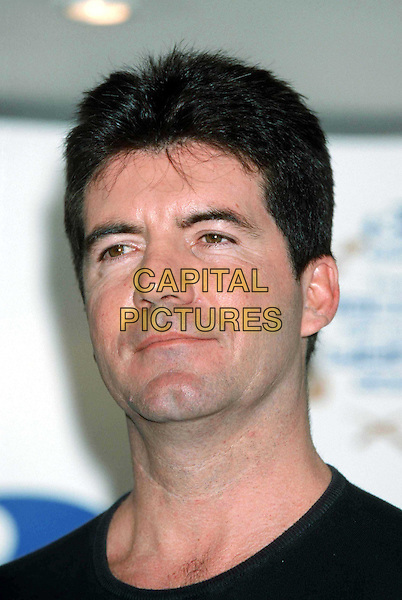 SIMON COWELL..Record Of The Year...Announcing The Shortlist At The Hard Rock Cafe..Ref: 11256..headshot, portrait..www.capitalpictures.com..sales@capitalpictures.com..©Capital Pictures..