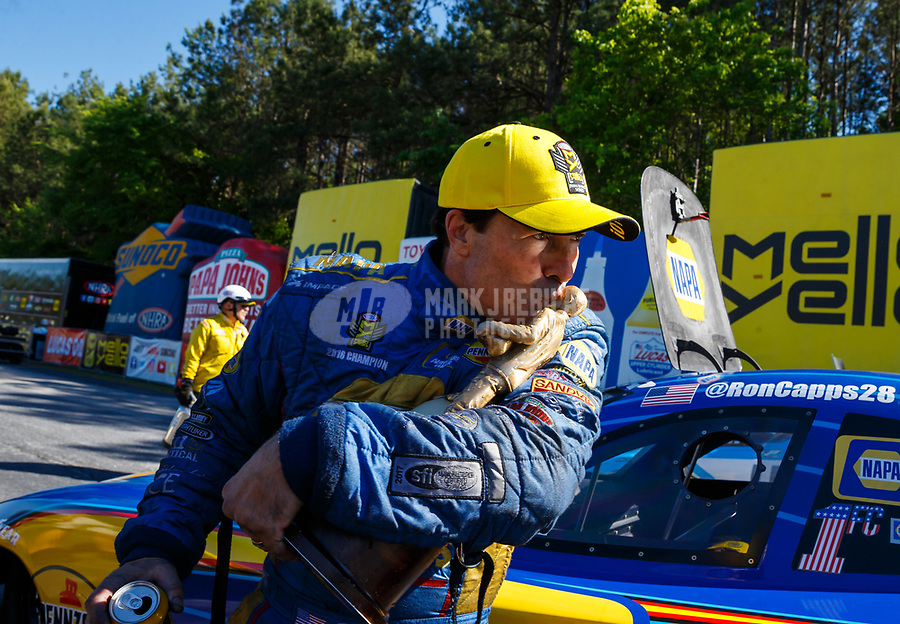 May 7, 2017; Commerce, GA, USA; NHRA funny car driver Ron Capps celebrates by kissing the Wally trophy after winning the Southern Nationals at Atlanta Dragway. Mandatory Credit: Mark J. Rebilas-USA TODAY Sports