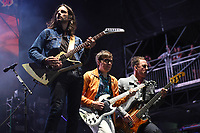 FORT LAUDERDALE BEACH, FL - DECEMBER 02: Brian Bell, Rivers Cuomo and Scott Shriner of Weezer perform during The Riptide Music Festival on December 2, 2017 in Fort Lauderdale Beach Florida. Credit: mpi04/MediaPunch