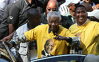 Former president Nelson Mandela leaves Ellis Park Stadium assisted by his grandson Mandla Mandela. They had attended the African National Congress (ANC) party's final Siyanqoba (victory) rally before the 2009 general election.