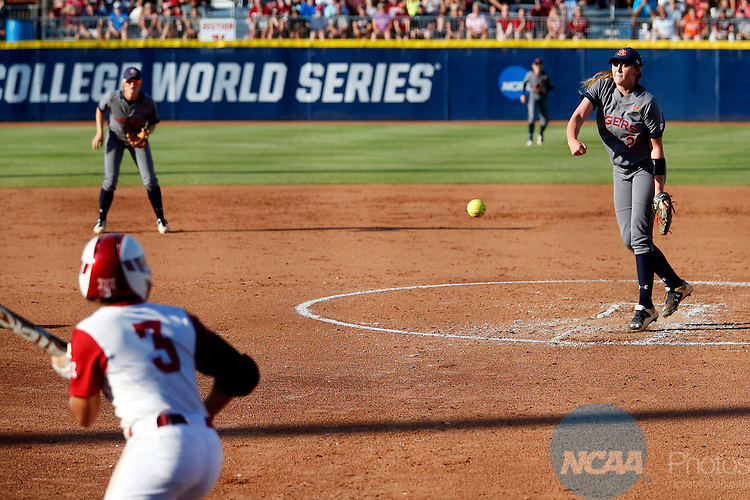 08 JUNE 2016:  Auburn starting pitcher/relief pitcher Makayla Martin (29) throws a pitch as Oklahoma infielder Kelsey Arnold (3) attempts a bunt during the Division I Women's Softball Championship is held at ASA Hall of Fame Stadium in Oklahoma City, OK.  Shane Bevel/NCAA Photos