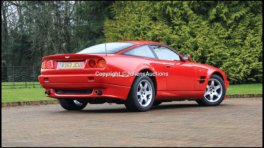 BNPS.co.uk (01202)558833Pic: JuliensAuctions/BNPS<br /> <br /> Middlesborough Red? - Chairman Steve Gibson's super rare Aston Martin for sale..for a Premier League stars weekly wage.<br /> <br /> One of the rarest and most desirable supercars of the past 25 years has emerged for sale for £160,000.<br /> <br /> The Aston Martin Virage Vantage V550 is one of just 239 to be manufactured and has had just three owners in its 21 year life.<br /> <br /> The sportier, supercharged version of Aston's standard Vantage, V550s have become real favourites of collectors and this one remains in fantastic condition, having covered just 61,000miles in over two decades.