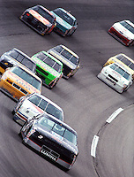 Dale Earnhardt leads a pack of cars off turn four at Talladega in May of 1993. (Photo by Brian Cleary/www.bcpix.com)