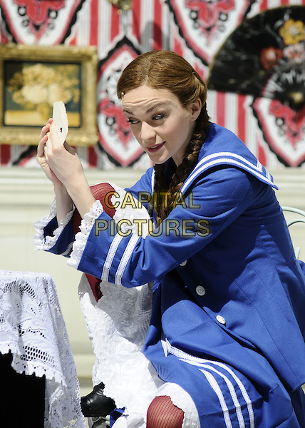 "LISA O'HARE .The ""Gigi"" photocall, Open Air Theatre, Regent's Park, London, England..August 12th, 2008.stage acting dress-up costume blue white striped stripes dress braids plaits half length.CAP/CAN.©Can Nguyen/Capital Pictures."