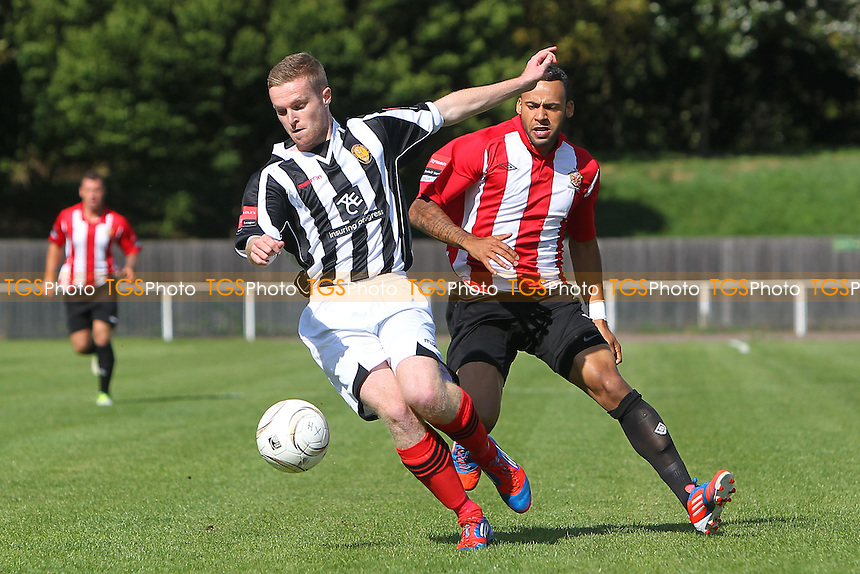 Tom Stephen of East Thurrock evades with Chris Bourne of AFC Hornchurch - AFC Hornchurch vs East Thurrock United - Ryman League Premier Division Football on Non-League Day at The Stadium, Upminster Bridge, Essex - 07/09/13 - MANDATORY CREDIT: Gavin Ellis/TGSPHOTO - Self billing applies where appropriate - 0845 094 6026 - contact@tgsphoto.co.uk - NO UNPAID USE
