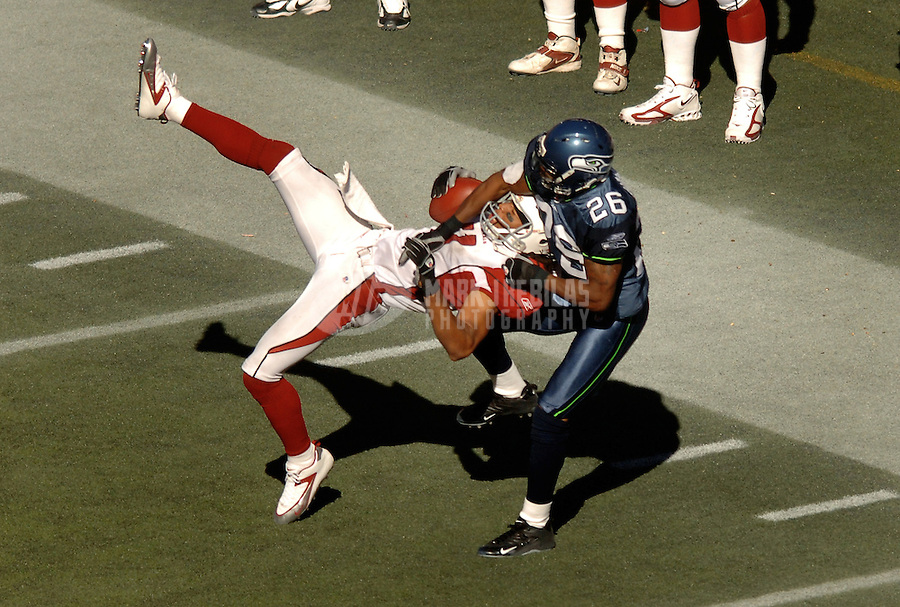 Sep 25, 2005; Seattle, WA, USA; Arizona Cardinals wide receiver #11 Larry Fitzgerald hauls in a pass under pressure from Seattle Seahawks free safety #26 Ken Hamlin in the third quarter at Qwest Field. Mandatory Credit: Photo By Mark J. Rebilas