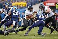 Philadelphia, PA - December 12, 2015:     Army Black Knights quarterback Chris Carter (7) avoids the Navy defender during the 116th game between Army vs Navy at Lincoln Financial Field in Philadelphia, PA. (Photo by Elliott Brown/Media Images International)