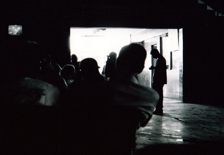 Passengers watch television while waiting in a bus station in Santa Clara, Cuba. MARK TAYLOR GALLERY