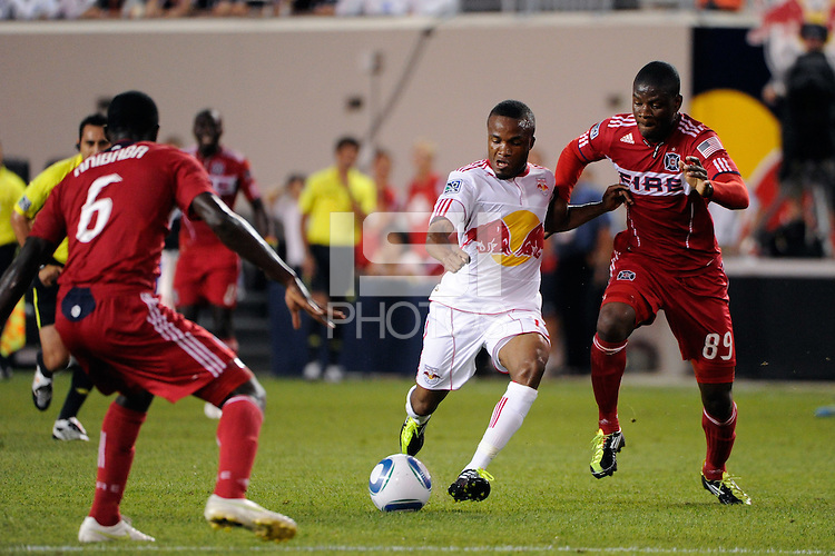 Dane Richards (19) of the New York Red Bulls is defended by Yamith Cuesta (89) of the Chicago Fire. The New York Red Bulls and the Chicago Fire played to a 2-2 tie during a Major League Soccer (MLS) match at Red Bull Arena in Harrison, NJ, on August 13, 2011.