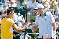 March 6, 2016: John Isner of USA shakes hands after winning the first reverse single match against Bernard Tomic of Australia at the BNP Paribas Davis Cup World Group first round tie between Australia and USA at Kooyong tennis club in Melbourne, Australia. USA won in 4 sets. Photo Sydney Low