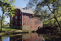 Medford, New Jersey,. Historic Kirby's Mill. It is reflected in the pond that supplies water to the mill wheel at right