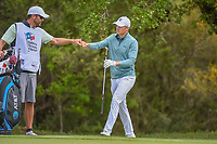 Jordan Spieth (USA) fist bumps caddie, Michael Greller after chipping in from off the green on 8 during day 4 of the Valero Texas Open, at the TPC San Antonio Oaks Course, San Antonio, Texas, USA. 4/7/2019.<br /> Picture: Golffile | Ken Murray<br /> <br /> <br /> All photo usage must carry mandatory copyright credit (© Golffile | Ken Murray)