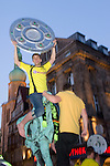 A fan is presenting the replica of the championship shield. - In the ancient marketplace in Dortmund fans celebrated a party because of the title win of their favorite soccer club BVB 09 in the German Premium League.
