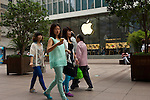 Shanghai - People's Republic of China, May 28, 2013 -- Huangpu District, Nanjing Lu / Road East, pedestrians pass by Apple's flagship store in the shopping mall; people, commerce, business -- Photo: © HorstWagner.eu