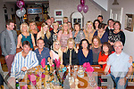 50 & FABULOUS: Kathryn Lucid Carroll, Ballyheigue (seated centre) got a super surprise for her 50th birthday party when she went to Bella Bia, Tralee last Saturday night only to find a large gathering of family and friends inside waiting to celebrate with her including her sisters who came home from New York and London for the occasion.