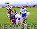Dromid's Nial O? Se? just gets the ball away from the strong challenges of St Mary's Conor Quirke.