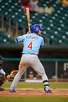 Tennessee Smokies outfielder Billy McKinney (4) at bat during a game against the Montgomery Biscuits on May 25, 2015 at Riverwalk Stadium in Montgomery, Alabama.  Tennessee defeated Montgomery 6-3 as the game was called after eight innings due to rain.  (Mike Janes/Four Seam Images)