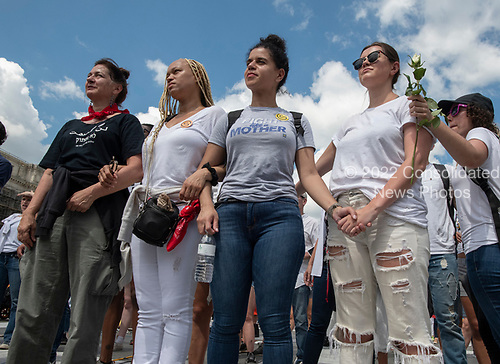"""Protestors lock arms at the """"Women's March in Civil Disobedience to End Family Detention"""" in Freedom Plaza in Washington, DC on Thursday, June 28, 2018.  <br /> Credit: Ron Sachs / CNP<br /> (RESTRICTION: NO New York or New Jersey Newspapers or newspapers within a 75 mile radius of New York City)"""