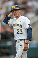 Michigan Wolverines assistant coach Nick Schnabel (23) against the Vanderbilt Commodores during Game 2 of the NCAA College World Series Finals on June 25, 2019 at TD Ameritrade Park in Omaha, Nebraska. Vanderbilt defeated Michigan 4-1. (Andrew Woolley/Four Seam Images)