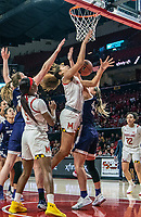 COLLEGE PARK, MD - JANUARY 26: Shakira Austin #1 of Maryland battles under the basket with Abi Scheid #44 of Northwestern during a game between Northwestern and Maryland at Xfinity Center on January 26, 2020 in College Park, Maryland.