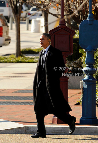 United States President Barack Obama walks across the street to return to the White House after attending a holiday party in the Blair House complex, on Friday, December 9, 2011, in Washington, DC.  .Credit: Leslie E. Kossoff / Pool via CNP