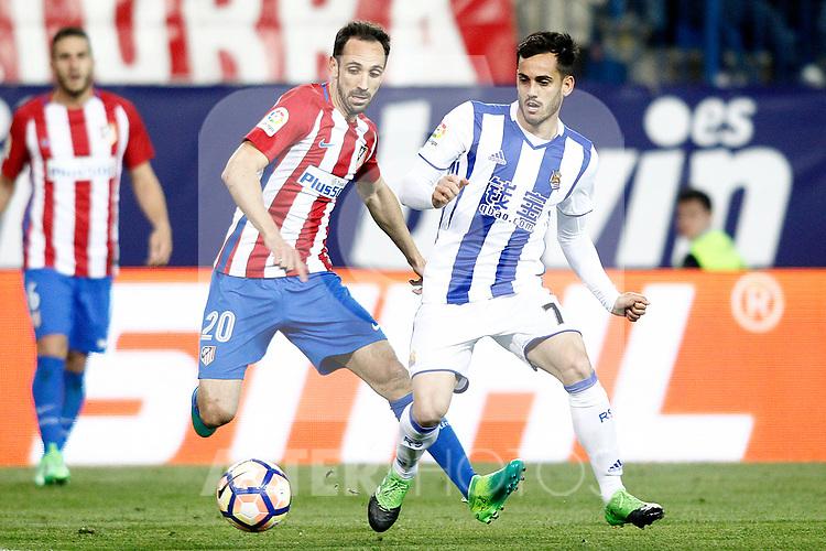 Atletico de Madrid's Juanfran Torres (l) and Real Sociedad's Juanmi Jimenez during La Liga match. April 4,2017. (ALTERPHOTOS/Acero)