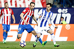 Atletico de Madrid's Juanfran Torres (l) and Real Sociedad's Juanmi Jimenez during La Liga match. April 4,2017. (ALTERPHOTOS/Acero)