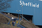 Two supporters pause while making their way up the stairs to the Kop stand before Sheffield Wednesday take on Peterborough United in a Coca-Cola Championship match at Hillsborough Stadium, Sheffield. The home side won by 2 goals to 1 giving Alan Irvine his third straight win since taking over as Wednesday's manager.