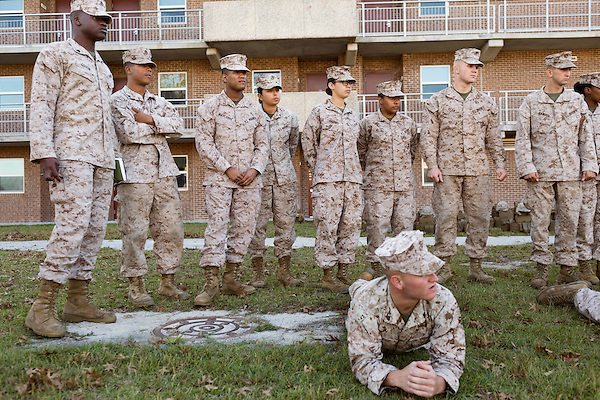 October 22, 2014. Camp LeJeune, North Carolina.<br />  Marines in 3rd Platoon of the Ground Combat Element Integrated Task Force listen to instruction before taking part in infantry patrol training. All Marines in the 3rd Platoon considered provisional infantrymen as they have not been to the School of Infantry (SOI) previous to volunteering for the GCEITF.<br />  The Ground Combat Element Integrated Task Force is a battalion level unit created in an effort to assess Marines in a series of physical and medical tests to establish baseline standards as the Corps analyze the best way to possibly integrate female Marines into combat arms occupational specialities, such as infantry personnel, for which they were previously not eligible. The unit will be comprised of approx. 650 Marines in total, with about 400 of those being volunteers, both male and female. <br />  Jeremy M. Lange for the Wall Street Journal<br /> COED