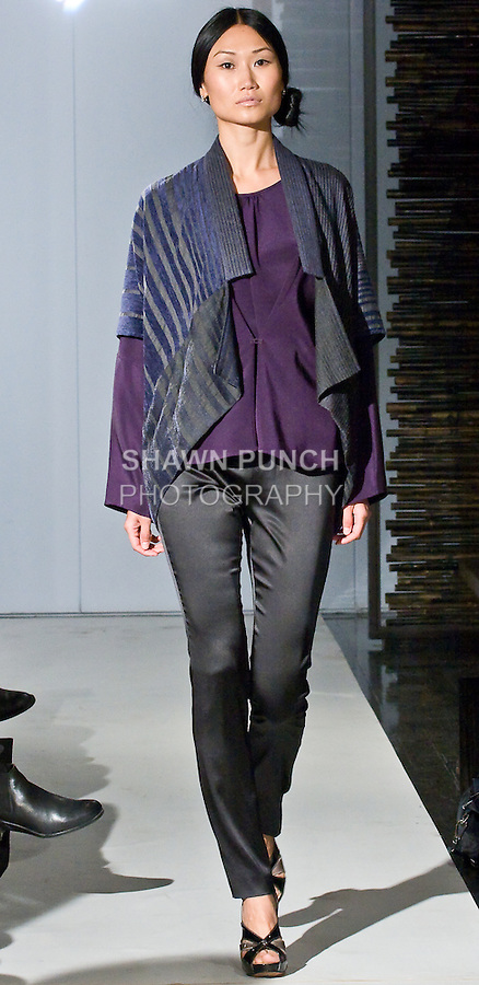 "Model walks the runway in a two way square jacket, silk tunic with front closure detail, and silk satin stretch pant, during the Blanc de Chine 2010 Fall Winter ""The Elegance of the Ming Design"" collection runway show on March 24, 2010."