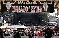 WACKEN Open Air 2009 - WOA - 20. Metal Festival im kleinen Metal-Dorf Wacken (Schleswig-Holstein) - beinahe 80.000 Besucher kamen auf den lautesten Acker der Welt - nearly 80.000 metalheads visits the 20th WOA - in picture / im Bild: stage view through the entrance / security area - Blick auf die Bühne - im Vordergrund die Sicherheitsschleuse.  Foto: Christin Kersten.