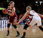 SIOUX FALLS, SD - MARCH 5:  Jaclyn Poss #12 of Denver drives against Caitlin Duffy #33 of South Dakota during their 2016 Summit League Tournament game. (Photo by Dave Eggen/Inertia)